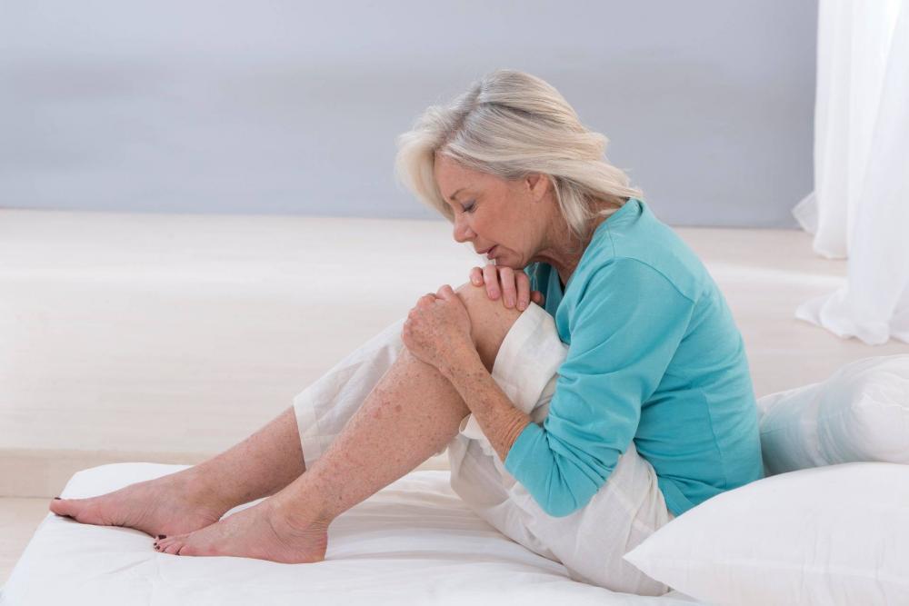 fájdalom a térdízületben a láb elforgatásakor